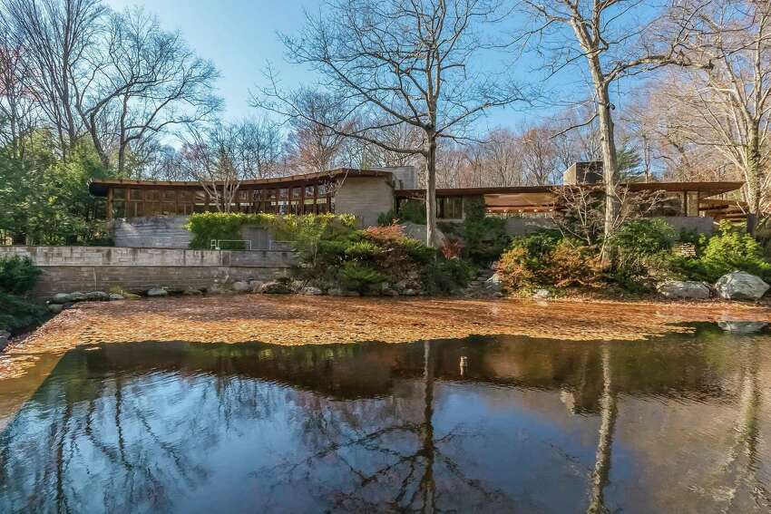 Tirranna, designed by iconic American architect Frank Lloyd Wright, includes the main house, a caretaker's cottage, barn, tennis court, swimming pool, observatory, and greenhouse.