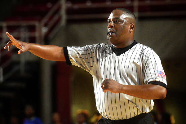 Pastor Carlton Sharp eyes the game action as he and fellow referees officiate during Friday night's rivalry match-up between Central and Ozen at the Montagne Center. Photo taken Friday, January 20, 2017 Kim Brent/The Enterprise
