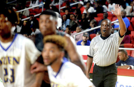 Pastor Carlton Sharp makes a call as he and fellow referees officiate during Friday night's rivalry match-up between Central and Ozen at the Montagne Center. Photo taken Friday, January 20, 2017 Kim Brent/The Enterprise Photo: Kim Brent / Beaumont Enterprise