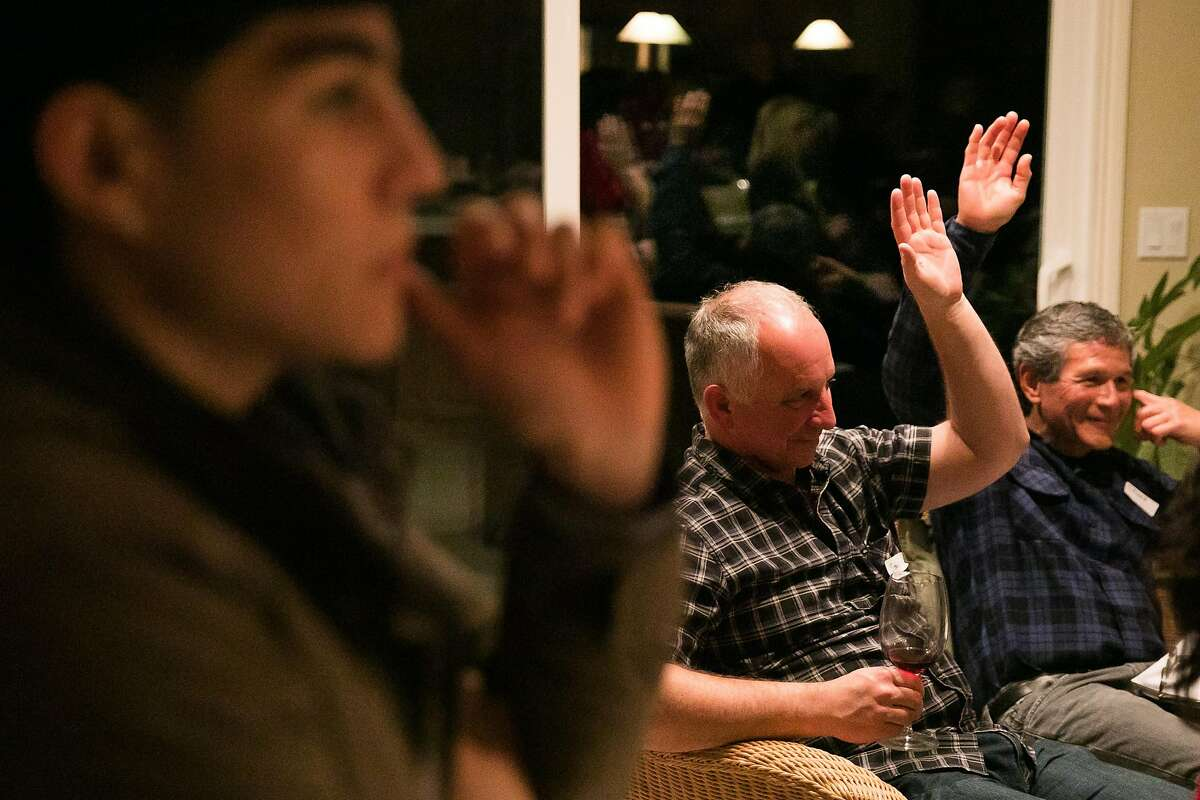 From the left, Bryant Acosta, Stan Zervas and Chuck Coleman participate on the first vote during Benicia/Vallejo Food Co-op's second meeting at Paula Schnese's house in Benicia, Calif., Saturday, January 21, 2017.