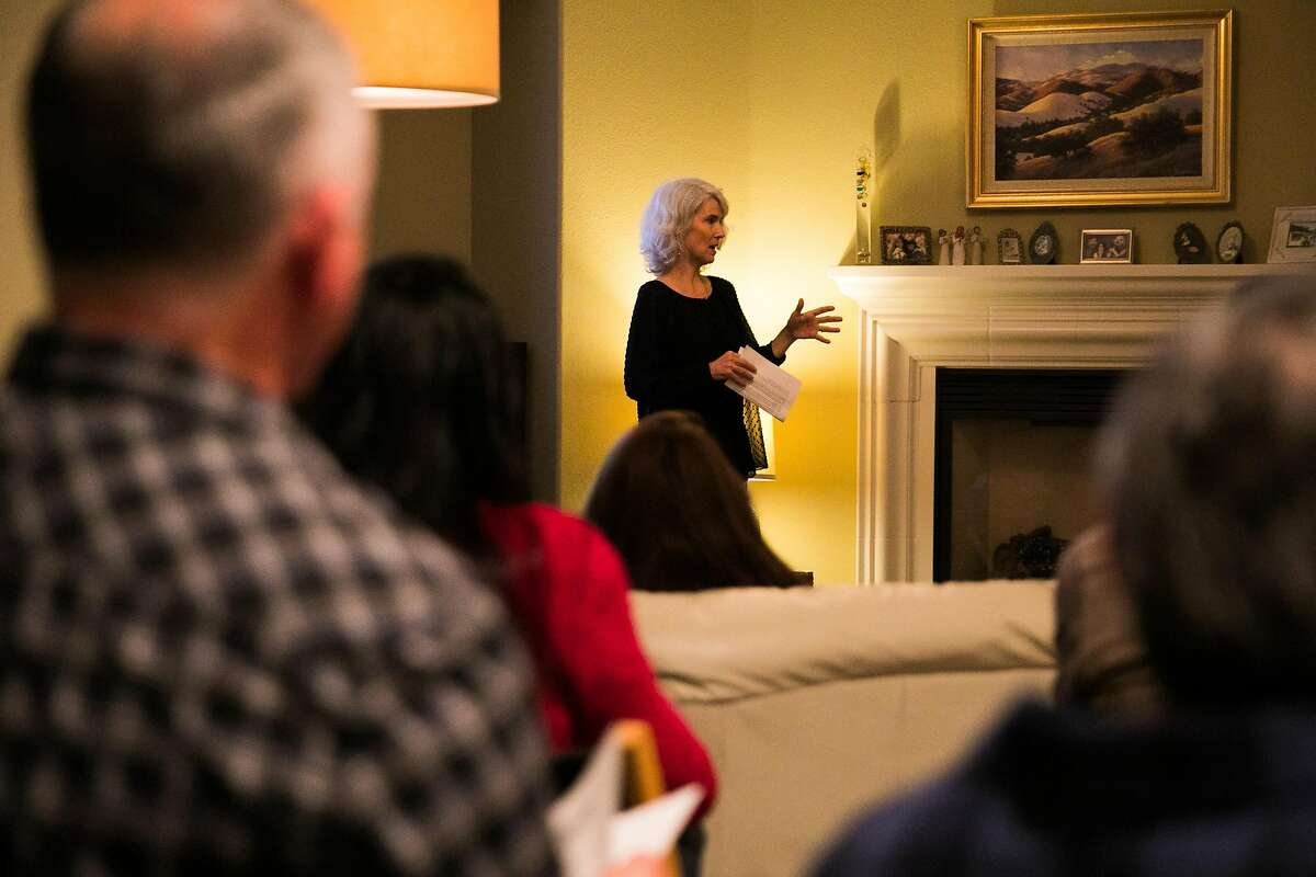 Paula Schnese, center, opens up the meeting by thanking and welcoming the committee at her house in Benicia, Calif., Saturday, January 21, 2017.