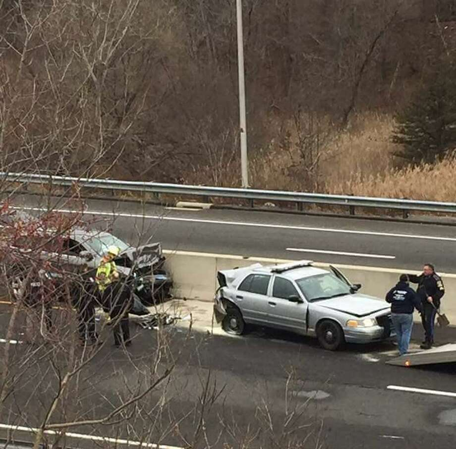 A State Police cruiser was involved in a two-car crash on northbound Route 7 in Brookfield on Monday, Jan. 23, 2017. State police say the cruiser was hit after the tropper stopped to assist a disabled vehicle. Photo: Joe T. Ribeiro Photo Via Connecticut State Police