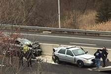 A State Police cruiser was involved in a two-car crash on northbound Route 7 in Brookfield on Monday, Jan. 23, 2017. State police say the cruiser was hit after the tropper stopped to assist a disabled vehicle.