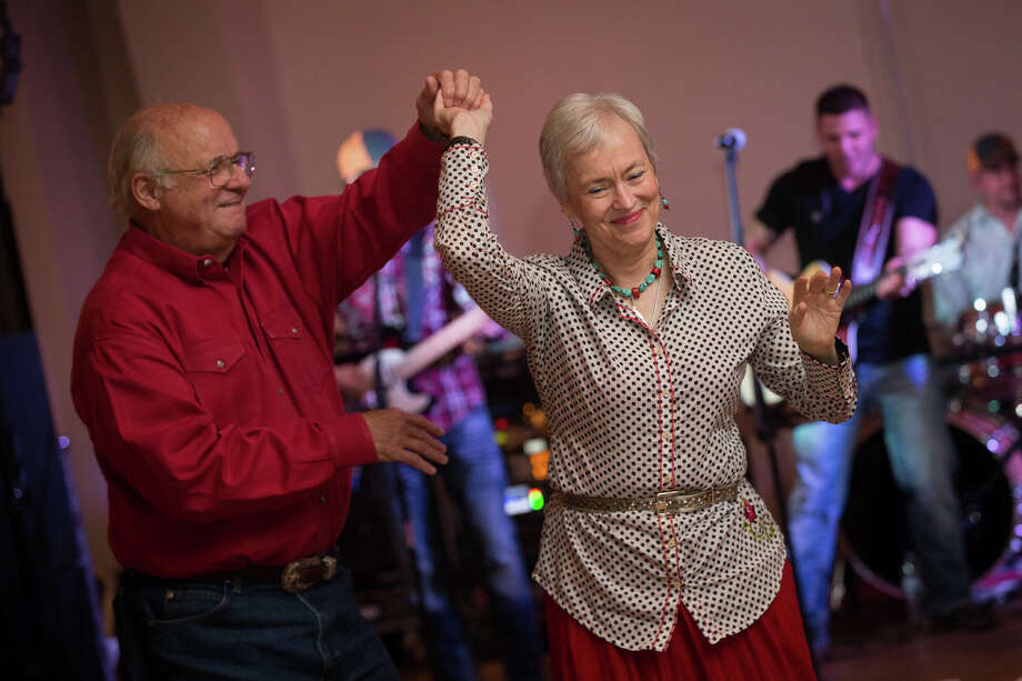 Houston residents John and Mary Lynn Faulk dance during the Boots, Buckles, and Bling North County Go Texan Dance on Friday at the Montgomery County Community Center. Photo: Michael Minasi, Staff Photographer / © 2017 Houston Chronicle