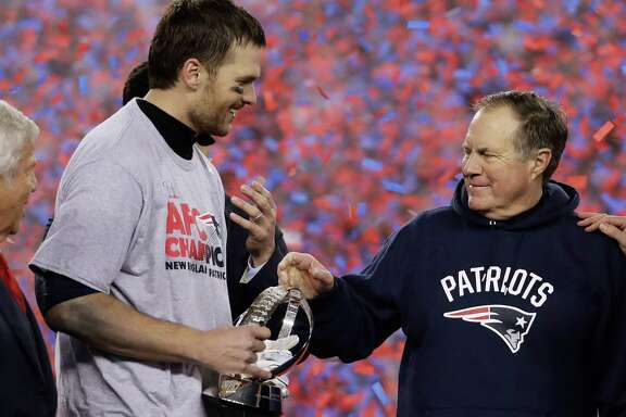New England Patriots quarterback Tom Brady, left, holds the AFC Championship trophyas he celebrates with head coach Bill Belichick after the AFC championship NFL football game, Sunday, Jan. 22, 2017, in Foxborough, Mass. The Patriots defeated the the Pittsburgh Steelers 36-17 to advance to the Super Bowl.(AP Photo/Matt Slocum)