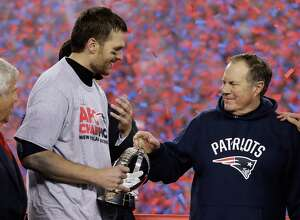 New England Patriots quarterback Tom Brady, left, holds the AFC Championship trophy as he celebrates with head coach Bill Belichick after the AFC championship NFL football game, Sunday, Jan. 22, 2017, in Foxborough, Mass. The Patriots defeated the the Pittsburgh Steelers 36-17 to advance to the Super Bowl. (AP Photo/Matt Slocum)