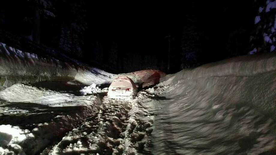 An avalanche came down on two cars near on Highway 89 near Tahoe City early Monday morning, causing an indefinite freeway closure, officials said.