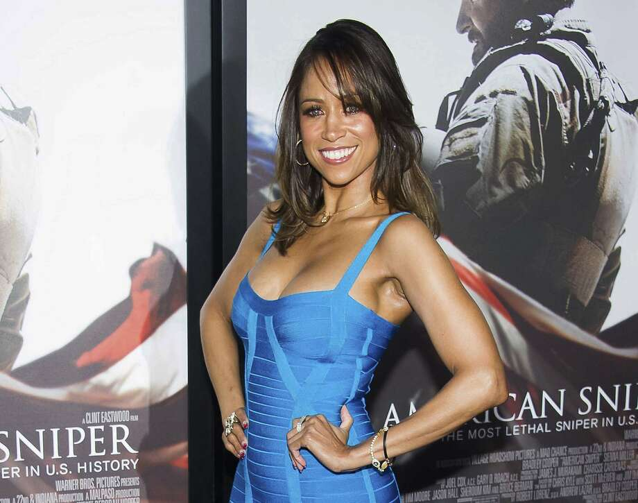 """FILE - In this Dec. 15, 2014 file photo, Stacey Dash attends the """"American Sniper"""" premiere in New York.  Fox News Channel is cutting ties with some of its paid contributors, including former """"Clueless"""" actress Stacey Dash and veteran conservative columnist George Will. The network said Monday, Jan. 23, 2017, that it had also declined to renew the contracts of political strategist Ed Rollins and columnist Cal Thomas. (Photo by Charles Sykes/Invision/AP, File) Photo: Charles Sykes, Associated Press"""