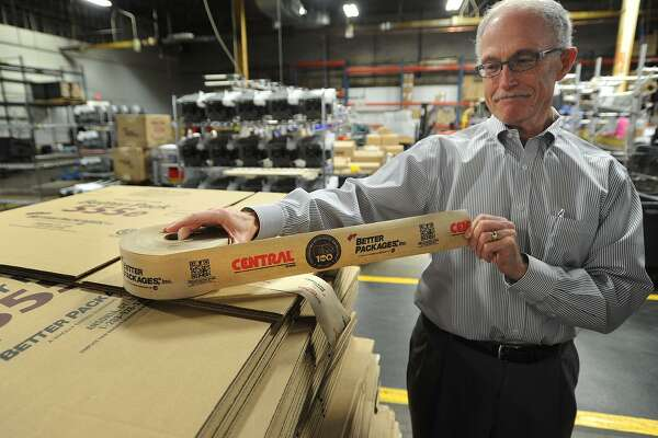 Philip White, CEO of Better Packages, Inc., shows a roll of specially printed tape commemorating the company's 100th anniversary at their headquarters and manufacturing facility in Ansonia, Conn. on Wednesday, January 11, 2017.