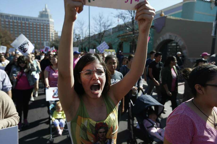 "Trinity student Olivia Garza shouts as she marches with about 1,200-1,500 people who gathered at City Hall on Saturday, Jan. 21, 2017 for San Antonio's version of the women's march happening in Washington, D.C. to oppose Donald Trump's inauguration. The march started in downtown and concluded at Estela's Mexican Restaurant on the city's Westside. Advertised as a march against ""hate, misogny, transphobia, homophobia, xenophobia,"" the organizers and protestors railed against Trump's comments against women and minorities. (Kin Man Hui/San Antonio Express-News) Photo: Kin Man Hui, Staff / San Antonio Express-News / ©2017 San Antonio Express-News"