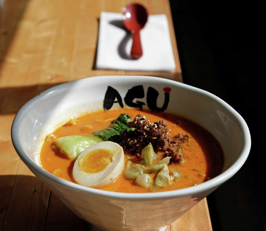 Tan Tan Tonkotsu comes with thicker noodles, ground pork miso, bok choy, zaasai and ahi tamago. Photo: James Nielsen, Staff / © 2017  Houston Chronicle