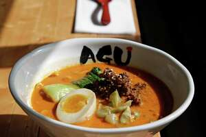 Tan Tan Tonkotsu comes with thicker noodles, ground pork miso, bok choy, zaasai and ahi tamago.