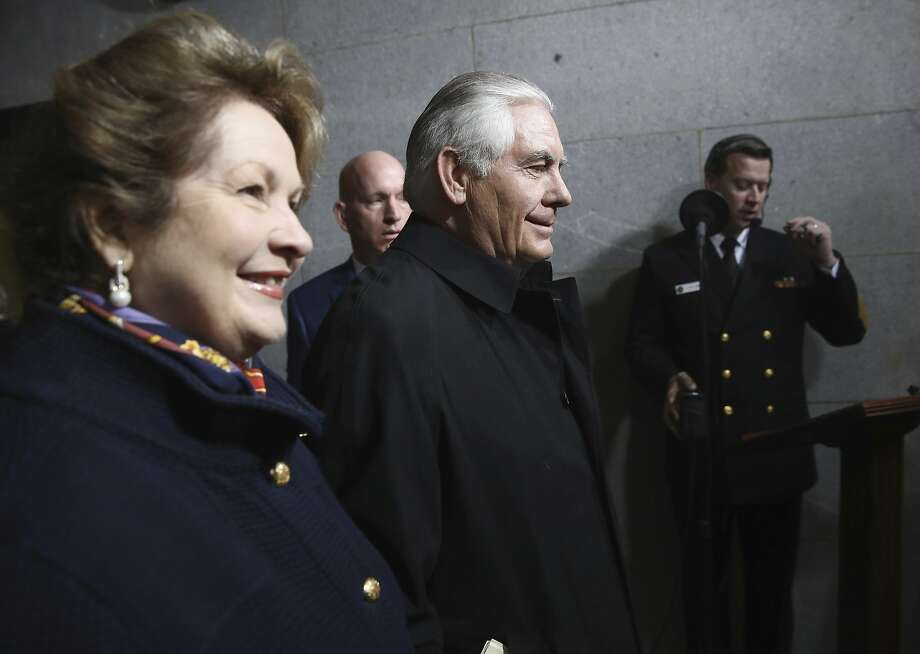 Former Exxon Mobil CEO Rex Tillerson and his wife, Renda, arrive at the Capitol before the Senate Foreign Relations Committee voted to confirm his nomination to be secretary of state. Photo: Win McNamee, Associated Press
