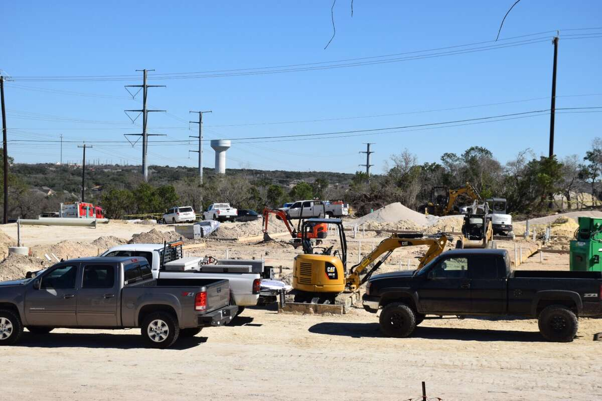 A 19-year-old construction worker was crushed to death by the backhoe bucket of a construction truck on Monday at a development site in the city's Far West Side.