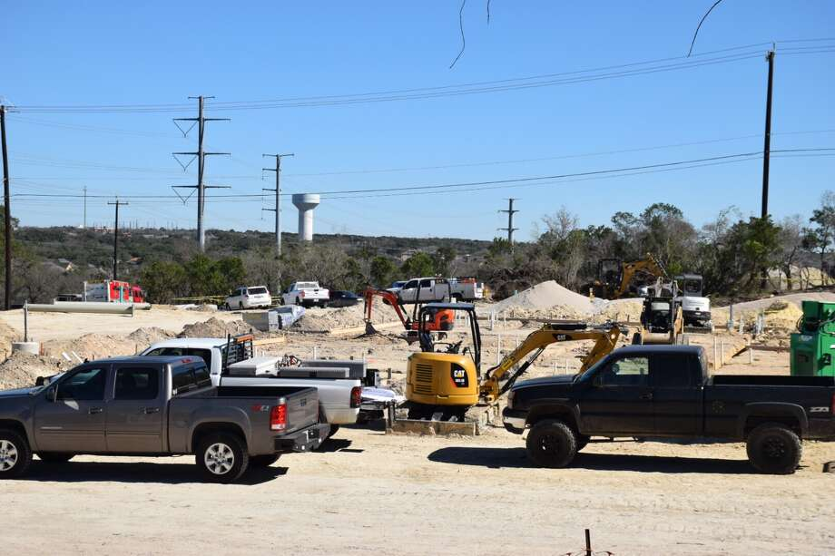 A 19-year-old construction worker was crushed to death by the backhoe bucket of a construction truck on Monday at a development site in the city's Far West Side. Photo: Caleb Downs, San Antonio Express-News / San Antonio Express-News
