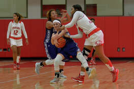 """Crosby 5'11"""" junior forward Paris Netherly, right, works for the ball against Dayton 5'3"""" sophomore guard Lara Natahali during their district matchup at Crosby High School on Jan. 20, 2017."""