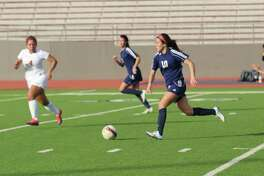 Roosevelt's Jessyca Figueroa Delgado (right) moves the ball up the field during a match in 2017.