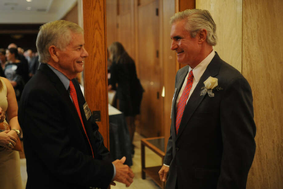 Representative Tom Craddick, left, talks with Tim Leach, CEO of Concho Resources, during a reception honoring Concho Resources at a meeting of the Midland Wildcat Committee on Oct. 25 at the Petroleum Club. Gov. Greg Abbott has named Leach to the Texas A&M board of regents. Photo: MRT File Photo