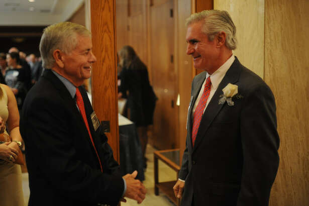 Representative Tom Craddick, left, talks with Tim Leach, CEO of Concho Resources, during a reception honoring Concho Resources at a meeting of the Midland Wildcat Committee on Oct. 25 at the Petroleum Club. Gov. Greg Abbott has named Leach to the Texas A&M board of regents.