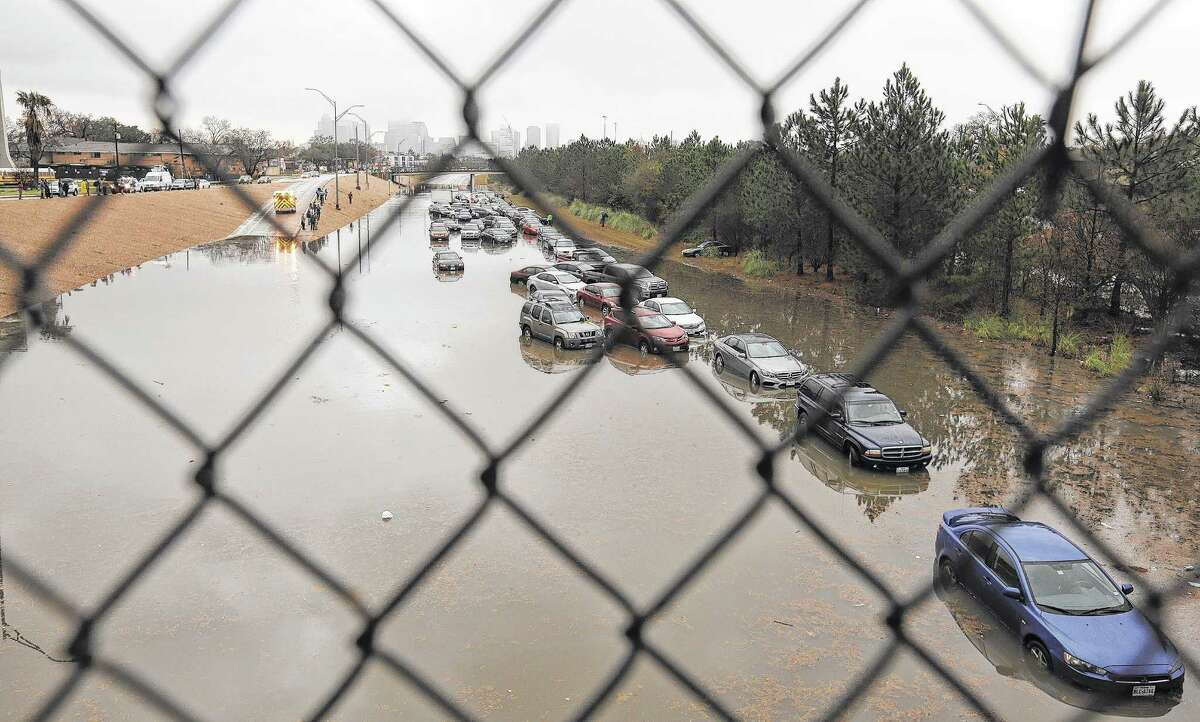 Drivers were forced to abandon their cars on a flooded section of Texas 288 near Calumet on Wednesday morning after heavy overnight rainfall.