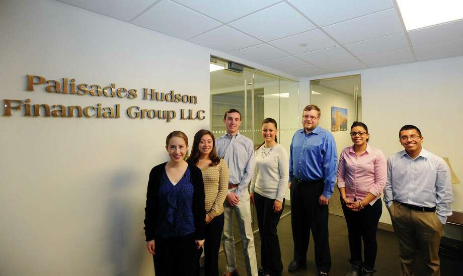 Most of the Palisades Hudson Financial Group staff, including VP Eric Meermann, third from right, at their new offices lat 300 First Stamford Place in Stamford on Wednesday. Photo: Michael Cummo / Hearst Connecticut Media / Stamford Advocate