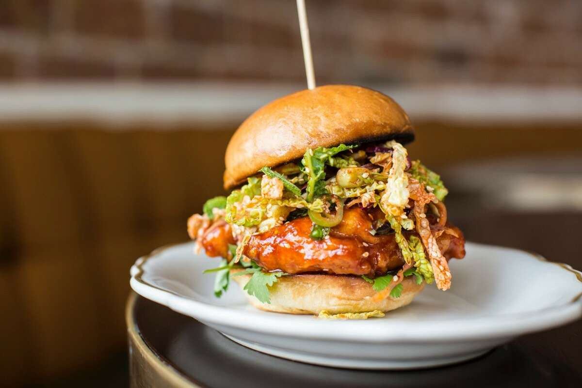 State of Grace restaurant in Houston offers a Korean-style hot fried chicken sandwich dressed with a Thai herb slaw.