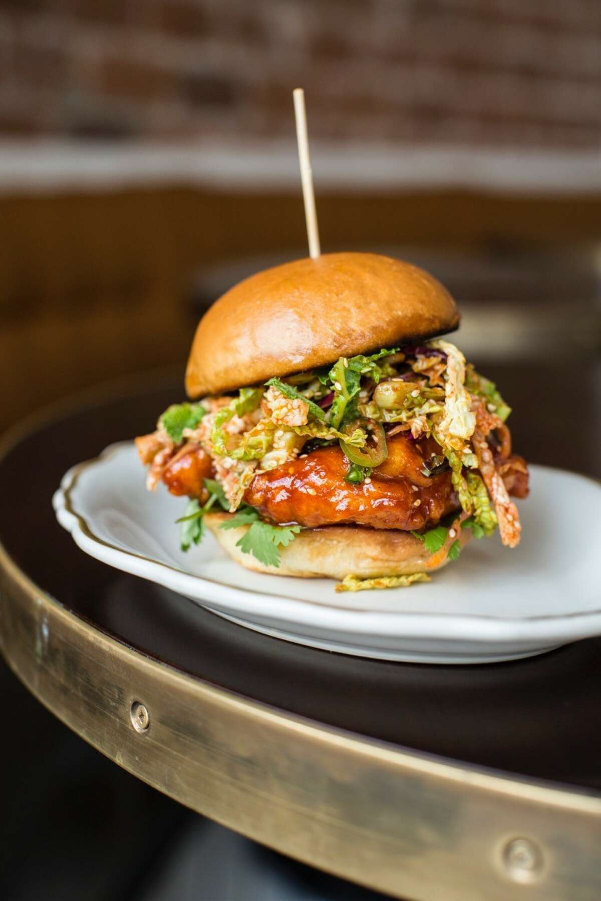 State of Grace serves a Korean-style hot fried chicken sandwich with a Thai herb slaw.