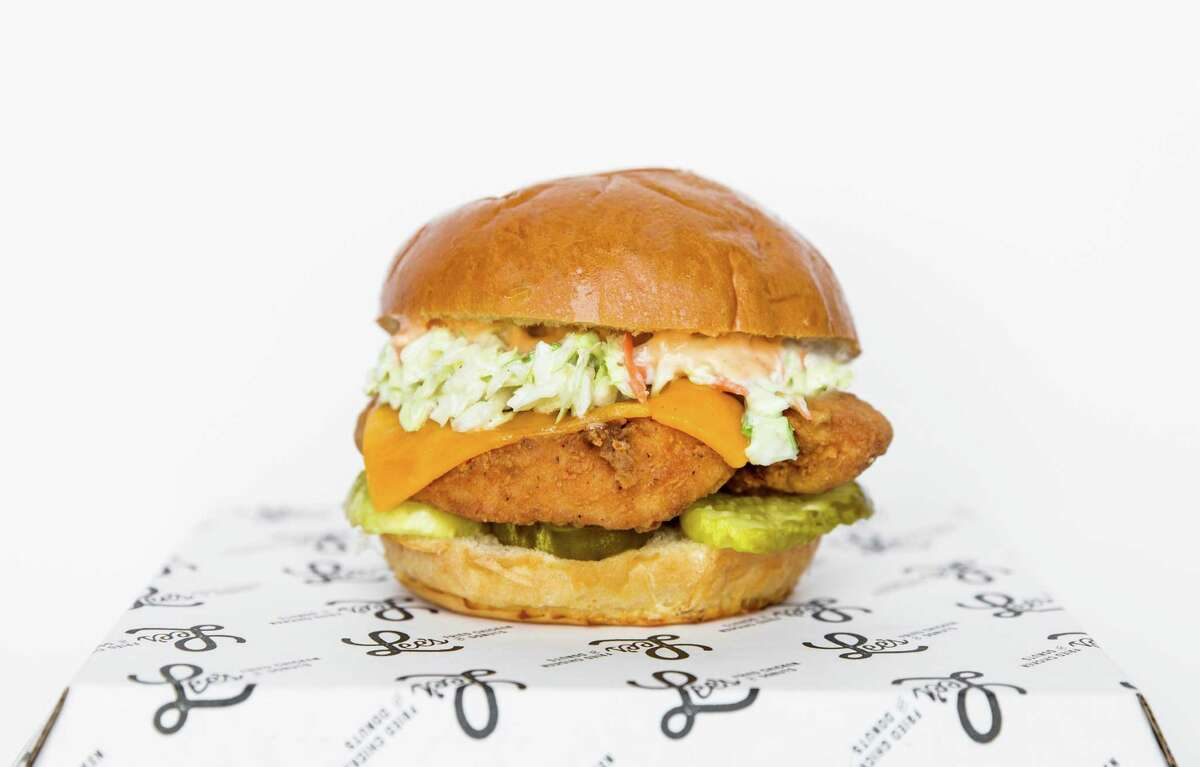 Lee's Fried Chicken & Donuts in the Heights offers a popular chicken sandwich (Lee's Fried Chicken Sandwich) made with fried chicken tenders, bread and butter pickles, hot sauce mayonnaise, cheddar cheese and the optional addition of cole slaw.