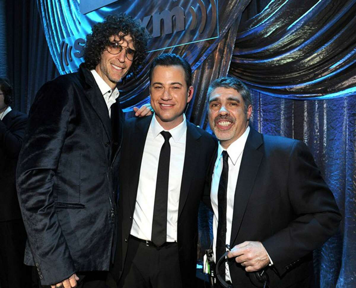 Greenwich resident Gary Dell'abate threw a star-studded birthday party for his boss Howard Stern in 2014. Above, Dell'Abate, right, and Stern, left, are joined by Jimmy Kimmel at the event,
