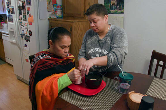 """Daisy Duarte, right, cares for her mother, Sonia, who was diagnosed with a genetic form of early-onset Alzheimer's in the PBS documentary """"Alzheimer's: Every Minute Counts."""""""