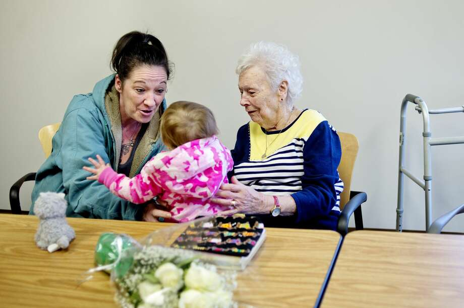 Brigid Thorn, left, and her great aunt Veronica Schmidt, right, visit with Genevieve Dent, 1, on Monday at Pinecrest Farms. Veronica is Genevieve's great great aunt. Veronica celebrated her 100th birthday with family and friends at Pinecrest. Photo: NICK KING | Nking@mdn.net