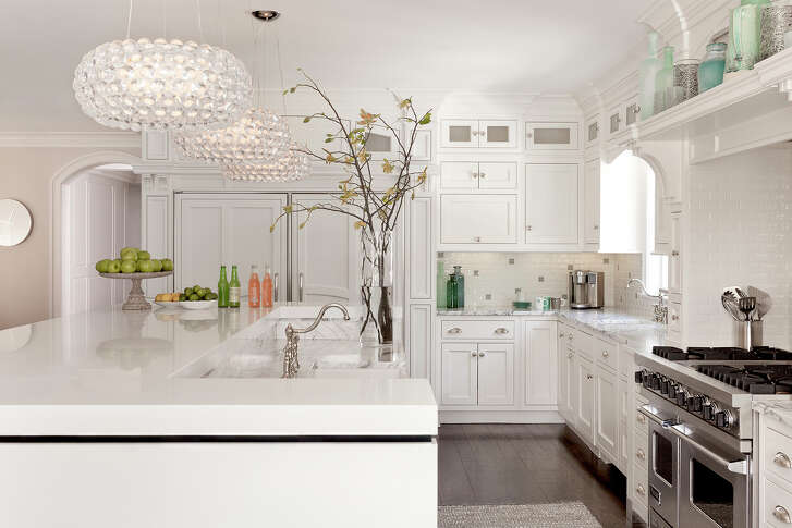 White paint provides an instant facelift for kitchen cabinets.