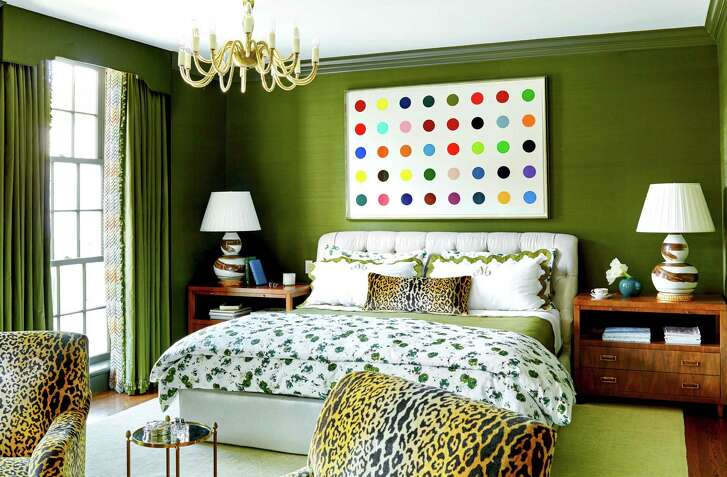 Dark green paint adds depth and personality to the master bedroom in the Houston home of Bailey McCarthy. Her home is featured in the new edition of House Beautiful magazine.