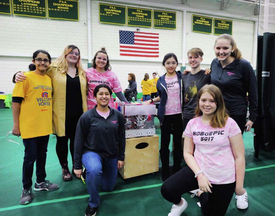 Greenwich Academy students and robotics team members from left, Sachi Laumas, Maddy Howe, Emily Fiorentino, Anisha Laumas (kneeling), Renee Ong, Megan DeMott, Grace Ryan and Kristen Tanner with their robot, Tigerlily, during the fourth annual Gator Bowl Connecticut State First Tech Challenge Qualifier Robotics tournament at Greenwich Academy on . Greenwich Academey science teacher Gail Sestito said 19 teams competed, including the Greenwich High School robotics team. Sestito said the host team, the Greenwich Academy Robotics team, RoboEpic, as is customary, did not compete. Evan Barnet, of First Tech Challenge said the tournament, through competition, hopes to expand robotic and engineering opportunities for the students who take part. Photo: Bob Luckey Jr. / Hearst Connecticut Media / Greenwich Time