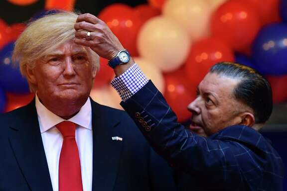 Gonzalo Presa, director of the Madrid Wax Museum, checks the hair of the Donald Trump figure during its unveiling. A reader hopes the real Trump keeps his promises and helps the economically disadvantaged.