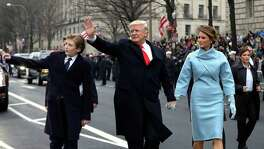 The first family — President Donald Trump and first lady Melania Trump, and son Barron Trump — walk the parade route after Friday's inauguration. Americans — and probably the president himself — have no idea what to expect now.