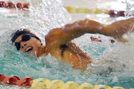 Edwardsville's Tyler Morris competes in the 100-yard freestyle during Saturday's triangular meet at Eisenhower Pool in Springfield.