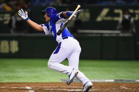 TOKYO, JAPAN - NOVEMBER 21:  Jaegyun Hwang #16 of South Korea hits a single in the top half of the second inning during the WBSC Premier 12 final match between South Korea and the United States at the Tokyo Dome on November 21, 2015 in Tokyo, Japan.