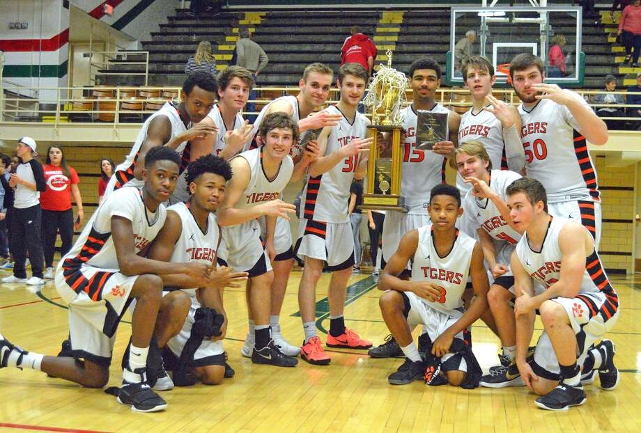 BOYS BASKETBALL Eville celebrates another Salem tourney title
