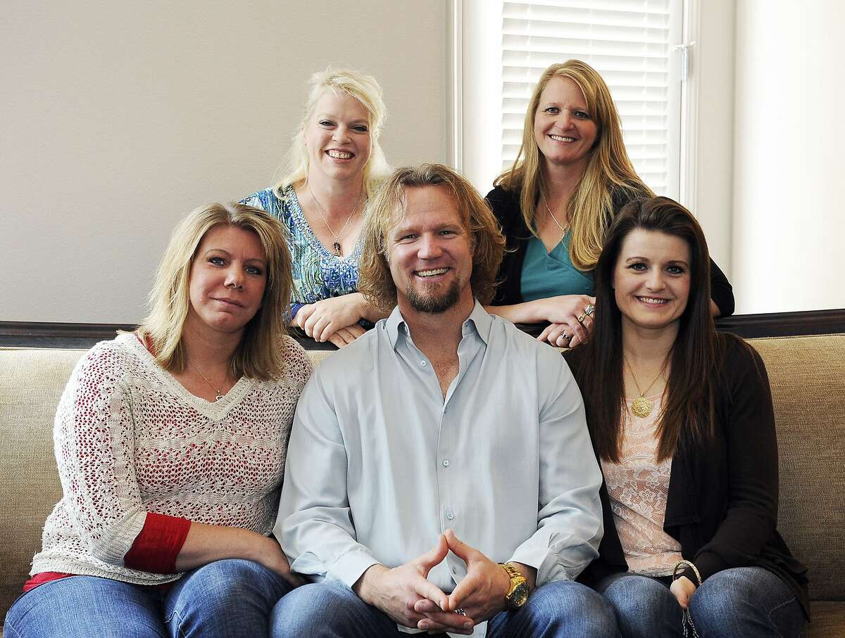 FILE - In this July 10, 2013, file photo, Kody Brown poses with his wives at one of their homes in Las Vegas. The Supreme Court said Monday, Jan 24, 2017, it won't hear an appeal from the family on TV's