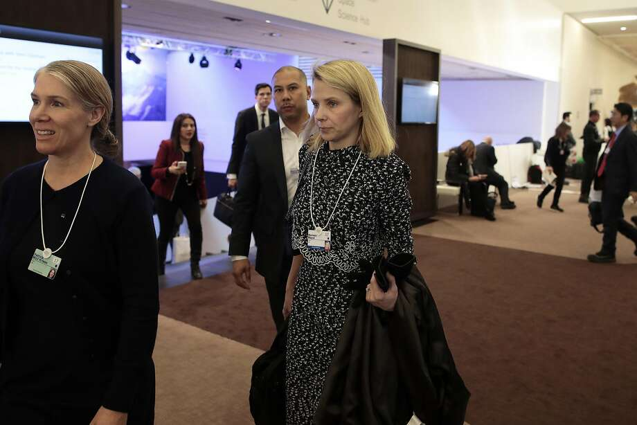 Marissa Mayer, chief executive officer of Yahoo! Inc., center, walks in the Congress Center between sessions during the World Economic Forum (WEF) in Davos, Switzerland, on Wednesday, Jan. 18, 2017. World leaders, influential executives, bankers and policy makers attend the 47th annual meeting of the World Economic Forum in Davos from Jan. 17 - 20. Photographer: Jason Alden/Bloomberg Photo: Jason Alden, Bloomberg