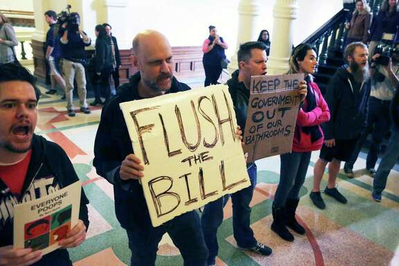 Protestors bhant in the hall as Lt. Governor Dan Patrtick announces legislation by Senator Lois Kolkhorst (R-Brenham) concerning bathroom access rules in Texas on January 5, 2016.