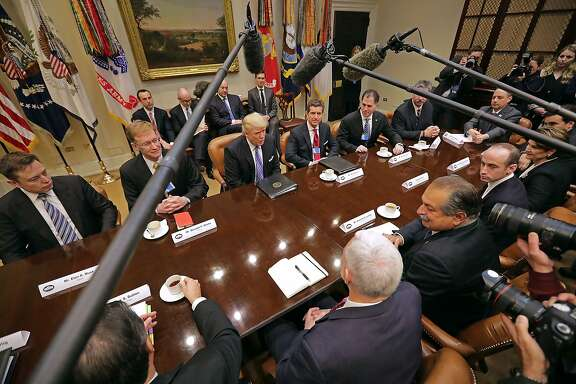 WASHINGTON, DC - JANUARY 23:  U.S. President Donald Trump (C) leads a meeting with invited business leaders and members of his staff in the Roosevelt Room at the White House January 23, 2017 in Washington, DC. Business leaders included Elon Musk of SpaceX, Wendell Weeks of Corning, Mark Sutton of International Paper, Andrew Liveris of Dow Chemical, Alex Gorsky of Johnston & Johnson and others.  (Photo by Chip Somodevilla/Getty Images) *** BESTPIX ***