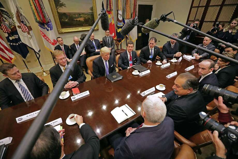 U.S. President Donald Trump (C) leads a meeting with invited business leaders and members of his staff in the Roosevelt Room at the White House January 23, 2017 in Washington, DC. Business leaders included Elon Musk of SpaceX, Wendell Weeks of Corning, Mark Sutton of International Paper, Andrew Liveris of Dow Chemical, Alex Gorsky of Johnston & Johnson and others. Photo: Chip Somodevilla / / 2017 Getty Images
