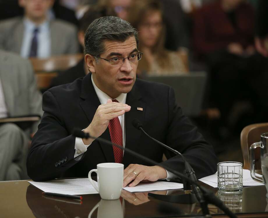 FILE- In this Jan. 10, 2017, file photo, Rep. Xavier Becerra, D-Calif., responds to a lawmakers question during during his confirmation hearing before the Assembly Special Committee on the Office of the Attorney General in Sacramento, Calif. In their first official action since Donald Trump became president, California lawmakers are poised vote Monday, Jan. 23, on confirming attorney general nominee, Becerra, who has vowed to defend the state�s liberal policies against the Trump administration and the Republican Congress. (AP Photo/Rich Pedroncelli, File) Photo: Rich Pedroncelli, Associated Press