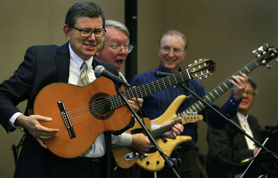 "Joe Gonzales (from left) sings ""The Ballad of Pancho Claus"" with Hank Harrison, Chuck Moses and Moses Olivo as friends and family members of local jazz violinist and music teacher Sebastian Campesi remember him. Photo: Bob Owen /San Antonio Express-News / ©2017 San Antonio Express-News"
