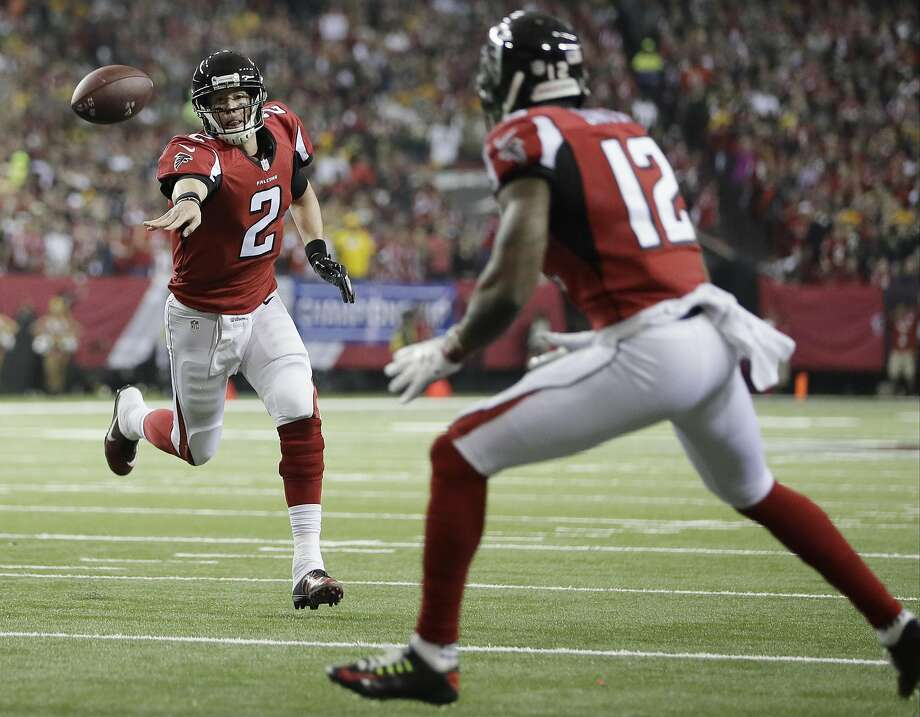 Atlanta's Matt Ryan improvises for a 2-yard touchdown pass to Mohamed Sanu in the first quarter of the Falcons' 44-21 rout of Green Bay in the NFC Championship Game. Photo: Mark Humphrey, Associated Press