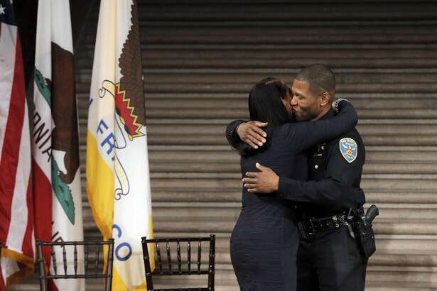 Newly sworn in San Francisco Police Chief, William Scott, right, kisses his wife, Frejeanne Scott at City Hall in San Francisco , Calif., on Monday, January 23, 2017.