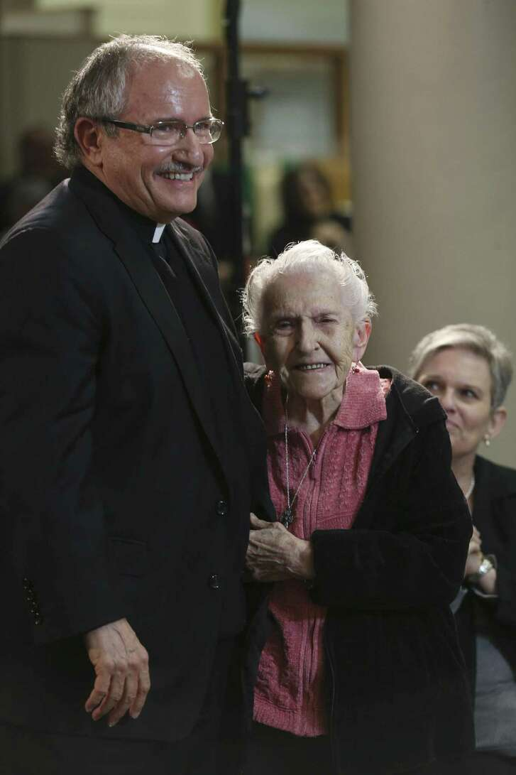 Monsignor Michael Joseph Boulette hugs his mother, Pat Boulette, 96, after his appointment as auxiliary bishop of the Archdiocese of San Antonio was announced Monday. Boulette was born in New York state, but grew up in Fredericksburg and attended high school in San Antonio.