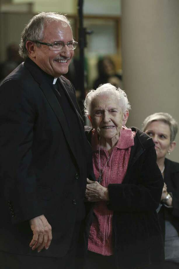 Monsignor Michael Joseph Boulette hugs his mother, Pat Boulette, 96, after his appointment as auxiliary bishop of the Archdiocese of San Antonio was announced Monday. Boulette was born in New York state, but grew up in Fredericksburg and attended high school in San Antonio. Photo: JERRY LARA /San Antonio Express-News / © 2017 San Antonio Express-News